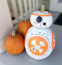 Star Wars: The Force Awakens has totally inspired my family. Here is a BB-8 droid Jack o'Lantern made with two stacked pumpkins, white spray paint, orange and sliver duct tape and a sharpie.