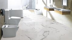 A beautiful bathroom made even better with our marble inspired Carrara X series tile. It's a coloured-base porcelain tile and is available in a Matte and Polished finish. River White Granite, Marble Look Tile, Carrara Marble, Olympia Tile, Wall And Floor Tiles, Flooring Tiles, Wall Tiles, Bathroom Renos, Master Bathroom