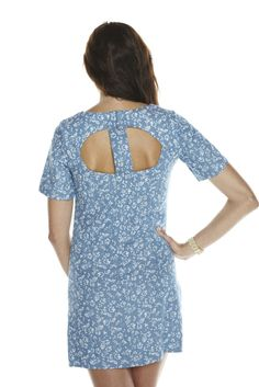 Blue floral-print dress with short-sleeves, cutout details, and slight A-line cut. This dress is perfect for any daytime outing, whether it be a walk on the pier or a day of shopping in the city. $169