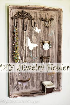 DIY Jewelry Holder from a Repurposed serving tray! A chic way to ucycle an old piece into a useful bit of furniture to display your jewelry. Now you can keep your jewelry organized, keep it from getting all tangled and a great piece for home decor.