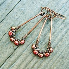 The colors of these freshwater pearls is gorgeous - ranging from deep rose to antique bronze - and they play so nicely with the antiqued copper! Five freshwater pearls are wrapped criss cross style along the bottoms of the hammered copper loops. Handcrafted ear wires have been shaped, hardened, antiqued, and polished smooth for comfort. The pair in the photos has a home, but I have made another identical pair, and they are ready to send. Total length including ear wires is 2 inches or 5 cm…