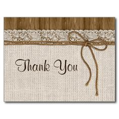 A beautiful, rustic Thank You card with burlap and lace and twine on brown wood.