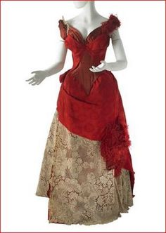 House of Worth, Evening Dress, 1885-86. The draped skirt is lined with taffeta and has interior tie-backs in the train. MCNY Collections.