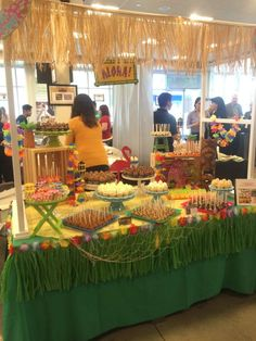 A fun Hawaiian themed party! Love the grass skirt decorating the table! See more party ideas at CatchMyParty.com