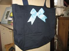 Check out this item in my Etsy shop https://www.etsy.com/listing/179145849/navy-tote-bag-waqua-polkadot-bow-and