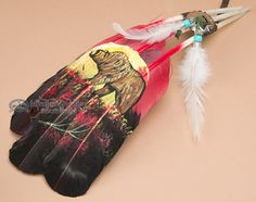 This is a grouping of three painted feathers is painted with Native American symbols of Native life. Popular as prayer feathers among American Indians and others for smudging and southwest decorating