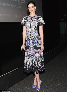Picture perfect: Krysten Ritter looked stunning in her black printed dress as she was pict...