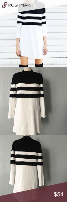 Sweater dress NWOT Fall into chic with this amazing dress, 10% cotton fabric so it's soft just like a sweater and it had stretch to it, just super chic. Black and white panels at top, long sleeves, great with tall black boots  ✅ will bundle ✅ ✅ all reasonable offers will be considered  No Trading  Poshmark rules only‼️ Measurements taken laying flat Ⓜ️ Chest 19  Ⓜ️ Length 33 1/2 boutique Sweaters