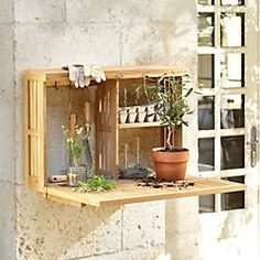 Outdoor Wall Workstation.. Bet a couple of crates could duplicate this idea.  I like it.
