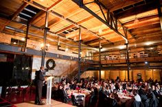 Photo taken of speaker at AARP event at Tobacco Warehouse District | Durham, NC