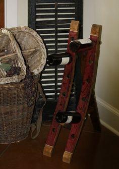 Retired wine barrel wine rack