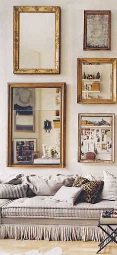 a wall of antique brass mirrors paired with tufted details + tassels ...classic.