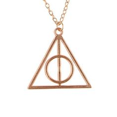 "Harry Potter Deathly Hallows Pendant Necklace – Silver, Gold, Bronze  Enter the Wizarding World of Harry Potter! [Inspired by the movies and books] Created by Death himself, the Deathly Hallows (Elder Wand, Resurrection Stone, Cloak of invisibility) make up the ultimate Wizard. No one but Harry Potter has been known to have been in command of all three at the same time Features the iconic Deathly Hallows symbol from the legendary story ""The Tales of Beedle the Bard"""
