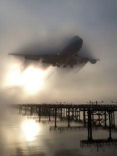 A 747 punches through a fog bank prior to landing at San Francisco International Airport