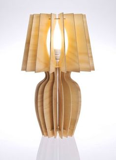 Laser cut this lamp is a witty rendition of the cclassic form. Kevin Webby : Lady Jane Table Lamp Timber