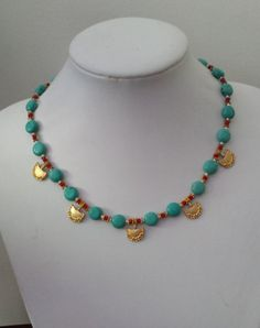 Turquoise and gold charm statement necklace by FashionLILLA