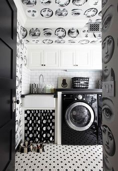 Fornasetti inspired wallpaper joins in the fun in this small Kitchen (or is it a Kitchen?) where black and white patterns abound.
