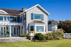Masterful architect Patrick Ahearn has transformed a summer cottage in West Hyannis Port on Cape Cod into a spectacular new oceanfront home. Portico Design, American Architecture, Architectural Elements, House Styles, Country Style House Plans, Summer Cottage, Ocean House, Views, House And Home Magazine