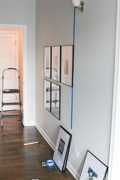 Tips to Hang a Symmetrical Gallery Wall in your Hallway How to hang a symmetrical gallery wall in your hallway to make a statement on a blank wall. Tips to get the frames hung just right so everything is level! Handmade Home Decor, Cheap Home Decor, Diy Home Decor, Up House, My Living Room, Decorating A Large Wall In Living Room, Living Room Gallery Wall, Gallery Walls, Hallway Decorating