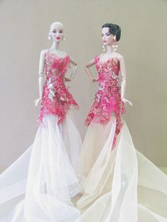 one blonde, one brunette, beautiful gown