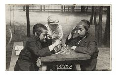 Boys playing chess at the Yehudia summer camp for Orthodox children. Dlugosiodlo, 1920s-30s. Photograph from Leo Forbert.