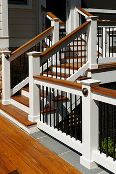 """level stained ipe deck with custom Azek railing and iron pickets. Upper screened"""
