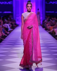 French fuchsia sari detailed with leheriya technique across. Embroidered gotapatti at the borders. Matching orange blouse adorned with an intricate detailing all over.Wash care: Dry clean only Disclaimer: There might be slight color variation in this item as these images are from the runway