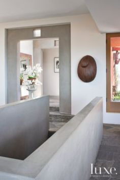 The #concrete-bordered #stairway inside a redesigned #1970s flat-roof home.