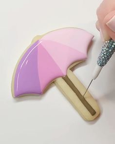 Purple Umbrella using Royal Icing and Pastel Pink Edible Glitter. Summer Cookies, Fancy Cookies, Iced Cookies, Heart Cookies, Valentine Cookies, Easter Cookies, Birthday Cookies, Christmas Cookies, Purple Umbrella