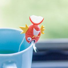 ♥ Magikarp Tea Bag Holder (Outside looking in)  ♥ This magikarp was trying to jump into you tea! Nah, just kidding. He was just curious as to what you were drinking :)  ♥Magikarp will help keep you company and also keep your tea bag string from slipping into your drink! Or he/she can be used as just a decoration for your delicious drinks!  ♥Hand made with hella care and attention using 100000% Polymer Clay. -Brands: Premo -Not glazed  ♥Size -Approximately 1.75 x 1.75 -****For thin and re...