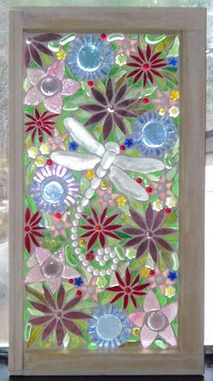 Glass mosaic on old window rimrockcreations.com. Love the flowers & dragonfly motif.