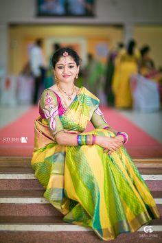 South Indian bride. Temple jewelry. Jhumkis. Yellow and green silk kanchipuram sari.Braid with fresh jasmine flowers. Tamil bride. Telugu bride. Kannada bride. Hindu bride. Malayalee bride.Kerala bride.South Indian wedding.