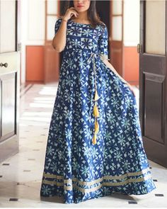 Indigo gown with fabric tassels
