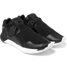 These 'QR Run' sneakers from Y-3 are a fresh take on the adidas 'Boost'. They are constructed from black mesh and feature tonal leather panels and white rubber soles. Wear them with tapered sweatpants to reference the brand's sportswear roots.