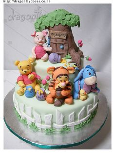 I LOVED THIS.   It inspired Logan's first birthday cake, although I couldn't find anyone around here to make the gumpaste figurines for a reasonable price.