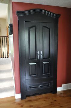 Faux Armoire | closet door made to look like a fancy armoire.  Armoire doors open for hanging clothes, bottom drawer opens for misc.