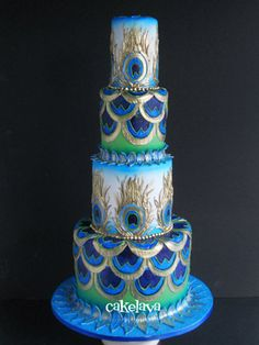 Tall, peacock feather themed wedding cake. Gorgeous!