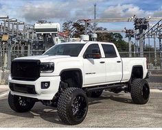 NEW WHITE GMC DENALI CUSTOMIZED AND MODIFIED WITH A LIFT WHEELS AND FRONT END