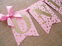 """Pink and Gold First Birthday Banner Decorate your Baby's first birthday in this Pink and Shimmering Gold high chair banner. This banner is a variation of 4"""" by 6"""" and 3.5"""" by 5.25"""" flags. Span: about"""