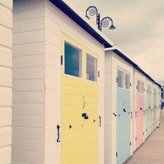 Beach huts in Lyme Regis. Lyme Regis Harbour, Dorset, England. With David Mitchell in Black Swan Green.