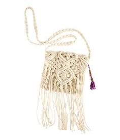 """Shoulder bag in macramé with fringes and a tassel."" -- If it wasn't leather with a tassel, it was macramé -- macramé everything!"