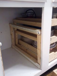 Kitchen Cabinets with DIY Drawers. Great detailed instructions & photos on how to build your own pull out kitchen cabinet shelves/drawers. LM 6-2013