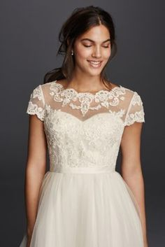 Unique Give a strapless gown a cap sleeve option with a beautiful lace overlay topper Cap