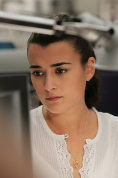 She looks at an old photo which shows Tali and her as kids.Sooo sad :,(