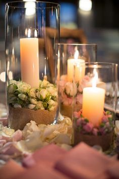 garden centerpiece with Rose buds surrounding the base of the candles! Simply gorgeous.