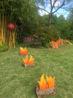"""Created by cutting out flames from foam board and adding spray paint. We attached the flames to yard stakes and put in between firewood. The kids loved jumping over these then crawling thru the """"hoops of fire"""" Más Ninja Birthday Parties, Fireman Birthday, Fireman Party, Birthday Ideas, Birthday Games, Lego Parties, Fireman Sam, 7th Birthday, Lego Ninjago"""