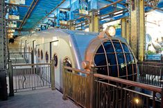 Funicular - Ocean Park in Hong Kong, one of the world's biggest theme parks. During the three-minute ride through a tunnel, passengers are given the sensation of a submarine dive into the deep sea aboard the famous Nautilus. Steampunk Theme, Steampunk House, Ocean Park Hong Kong, Hongkong, Thing 1, By Train, Train Travel, Dieselpunk, Night Time