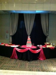 Pipe and drape behind cake table.  Wedding was black, fuchsia and silver.  I like the way it turned out.