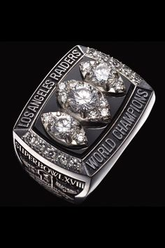 Super Bowl XLIX is this Sunday, and the champions will be awarded the crown jewel of the NFL, the Super Bowl ring. Nfl Raiders, Oakland Raiders, Raiders Los Angeles, All Nfl Teams, Super Bowl Rings, New Era Hats, Championship Rings, Crown Jewels, Men Watches