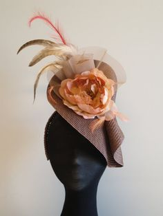 Stylish Mushroom/ Taupe Fascinator - this looks like a straw placemat folded with some flowers attached